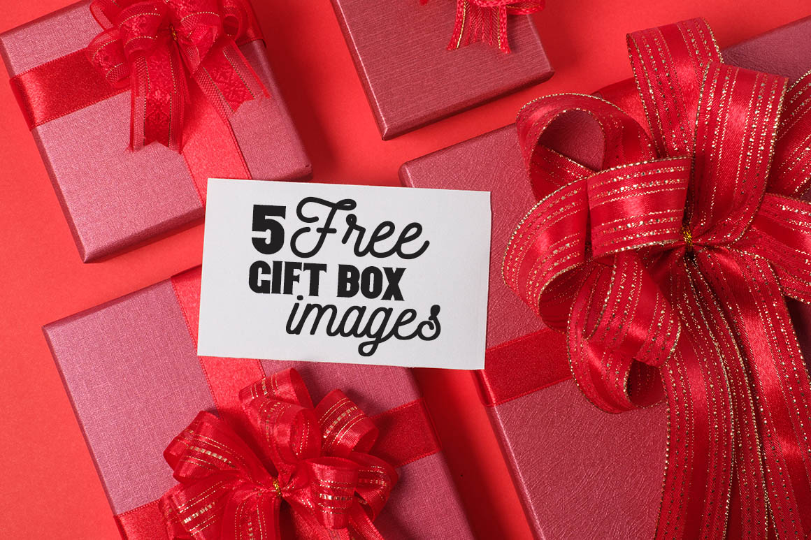 Red Gift Box with Decorations and Card on Red background with Copy Space.Merry Christmas and Happy New Year Holiday Concept